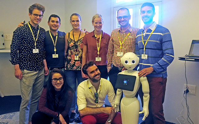 Barcelona GSE Data Science students with robot at Accenture Innovation Center