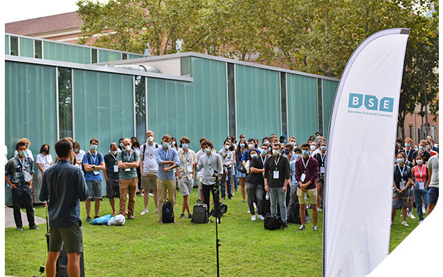 Students attend the welcome session outdoors with masks and social distancing for Covid-19 safety